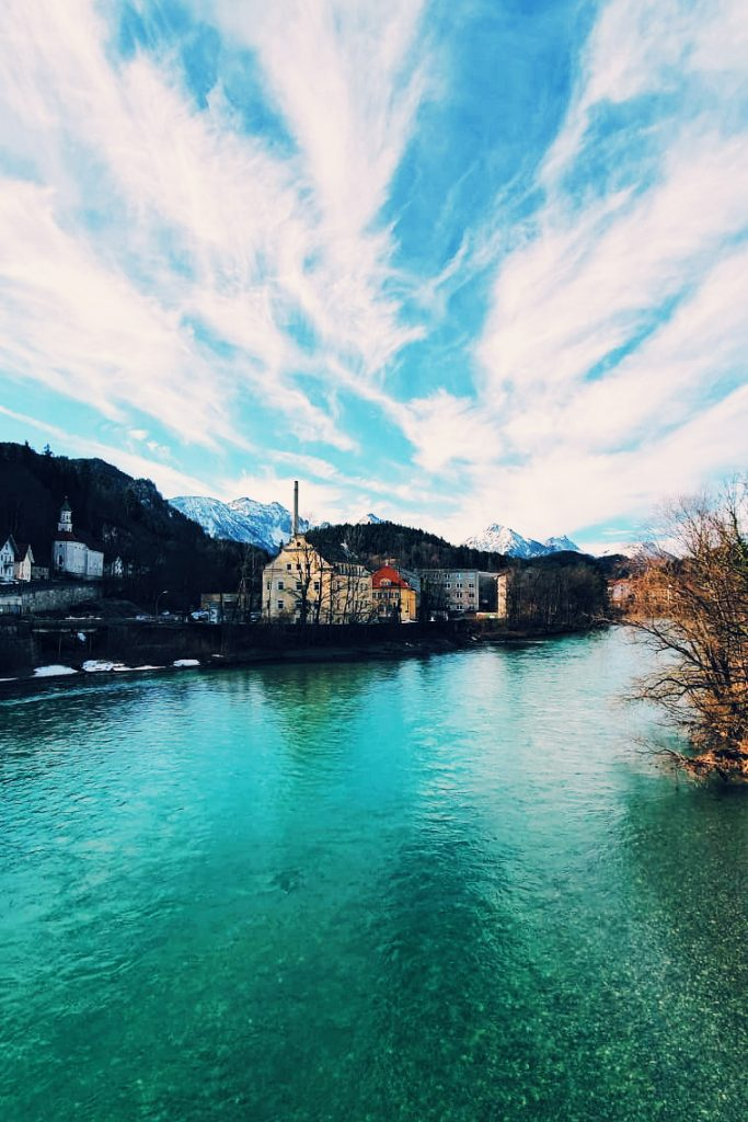 Photo taken of the clear blue water on the edge of Füssen town