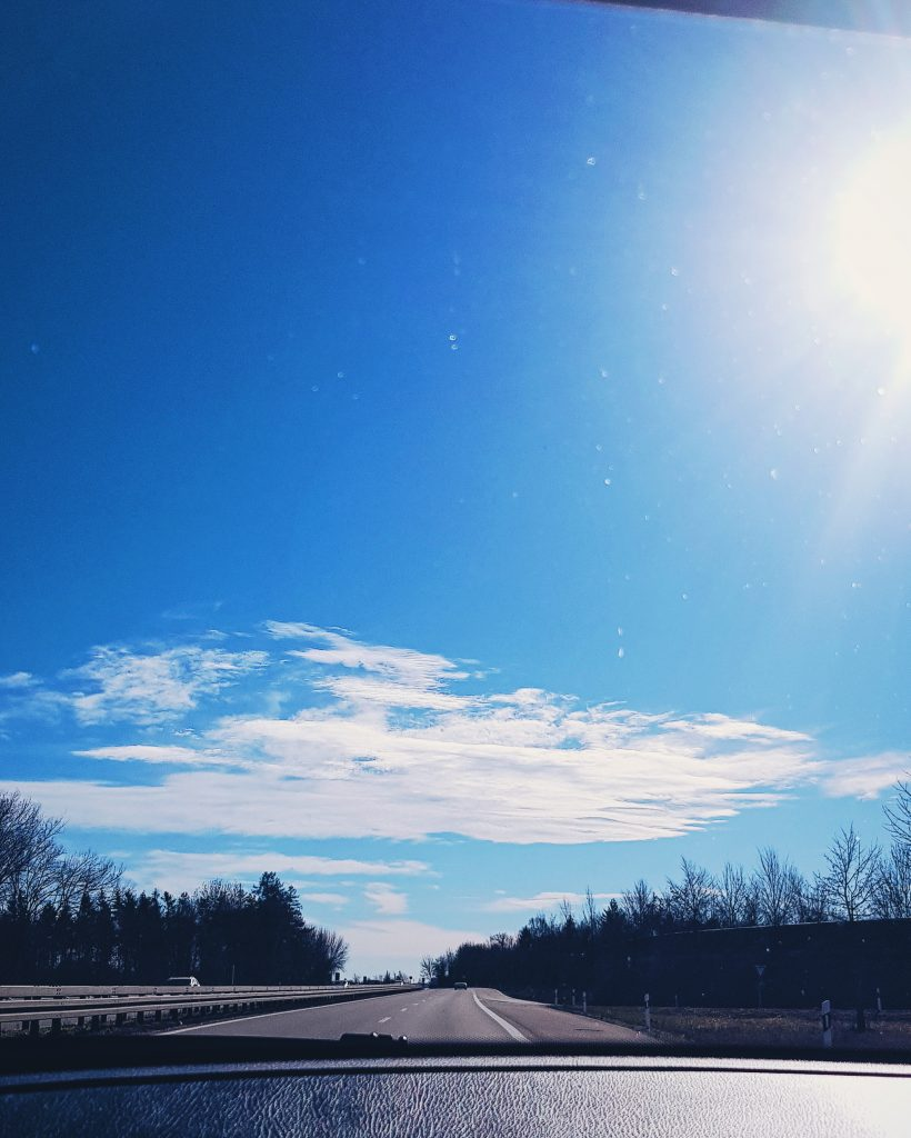 Blue skies with long empty road ahead