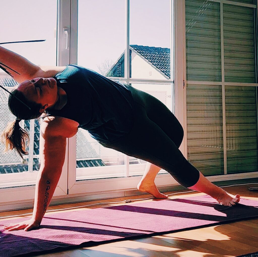 Steph in an extended side angle pose during her 100 days of yoga.
