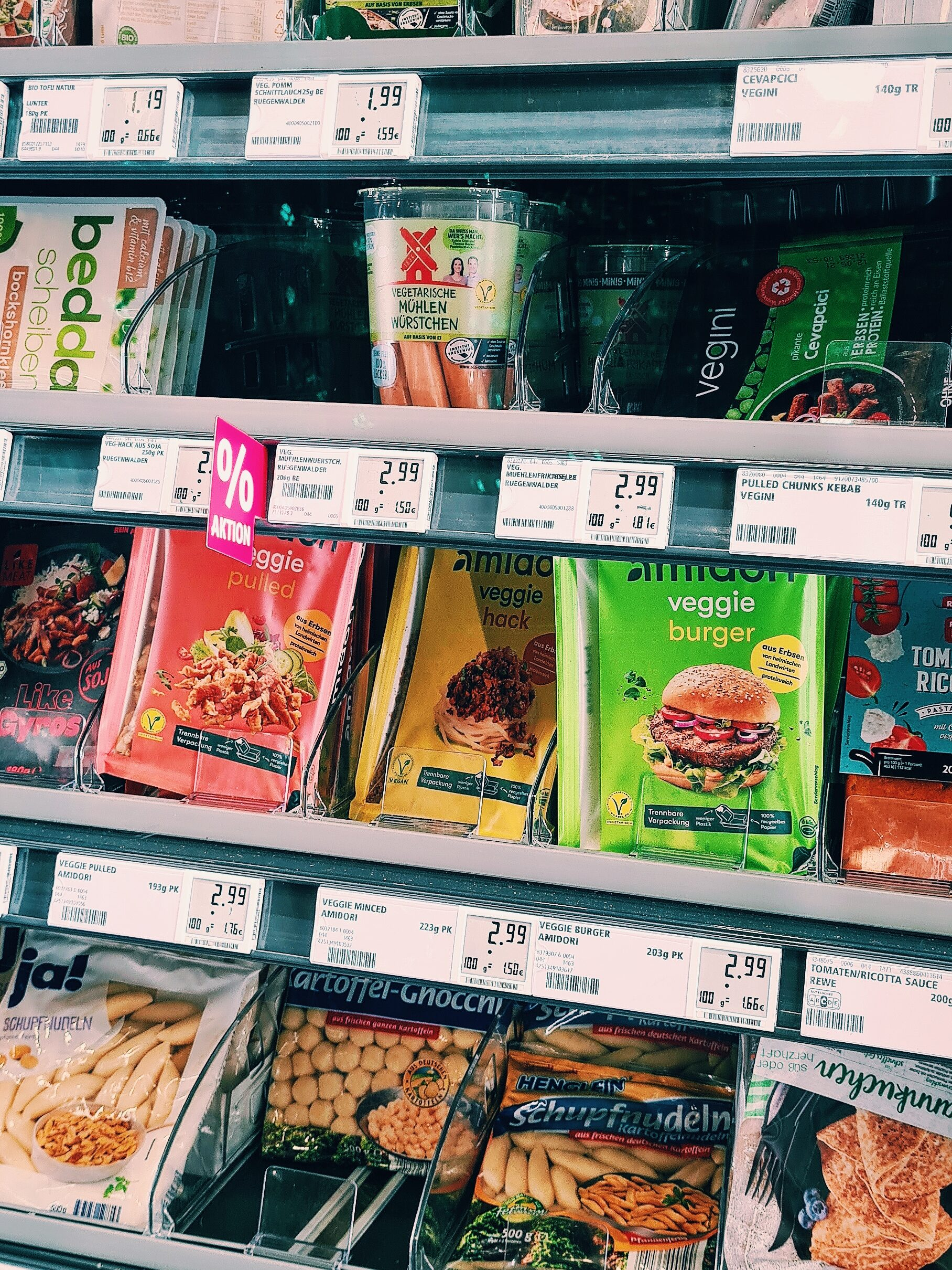 A photo of the refrigeratede vegetarian food section in the local Rewe supermarket.