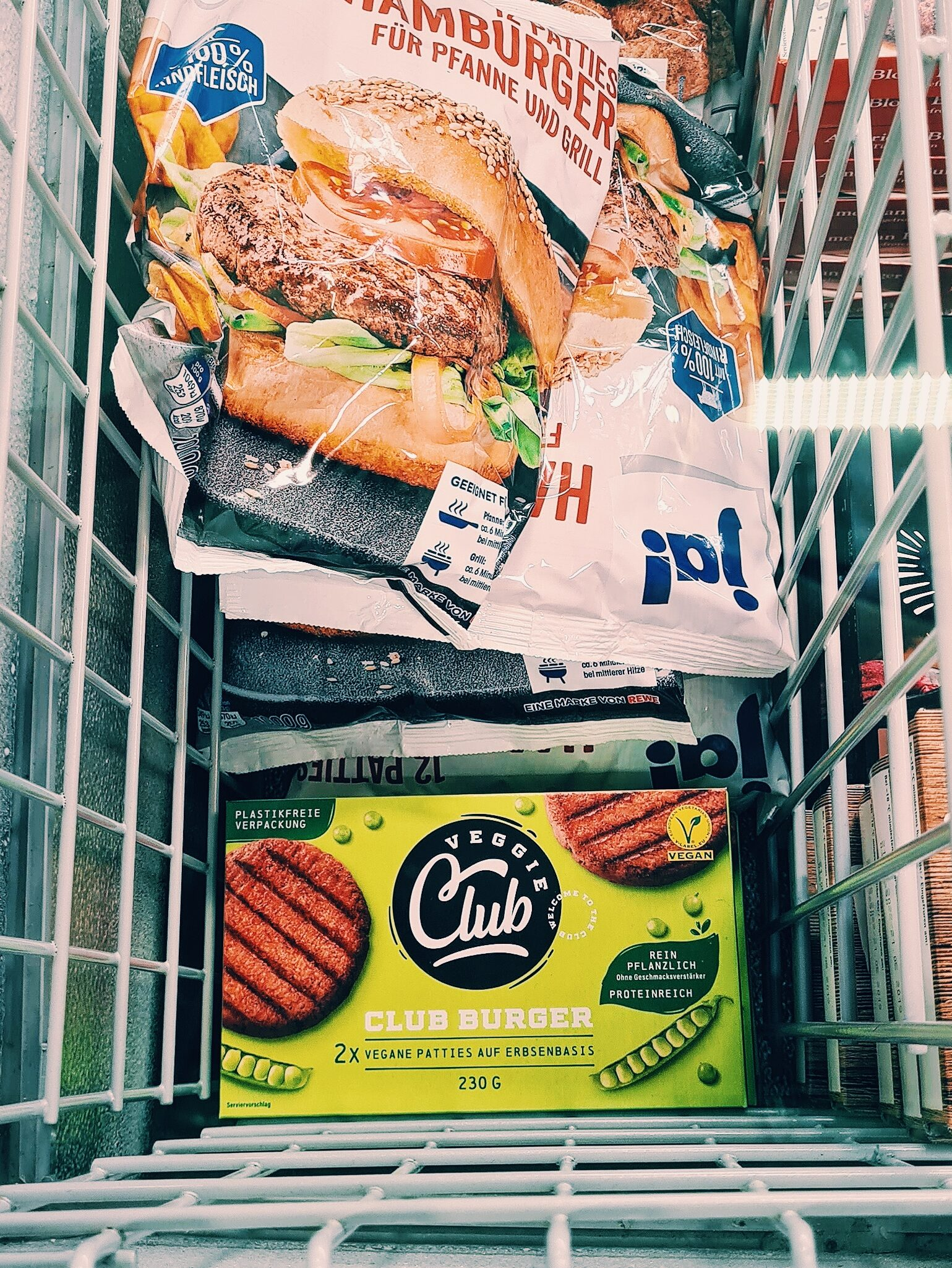 A photo of the meat-free burgers next to meat burgers in the frozen section of a supermarket.